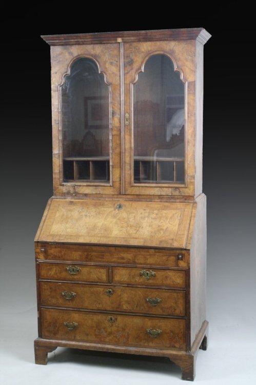 690: An early 18th century figured walnut bureau bookca