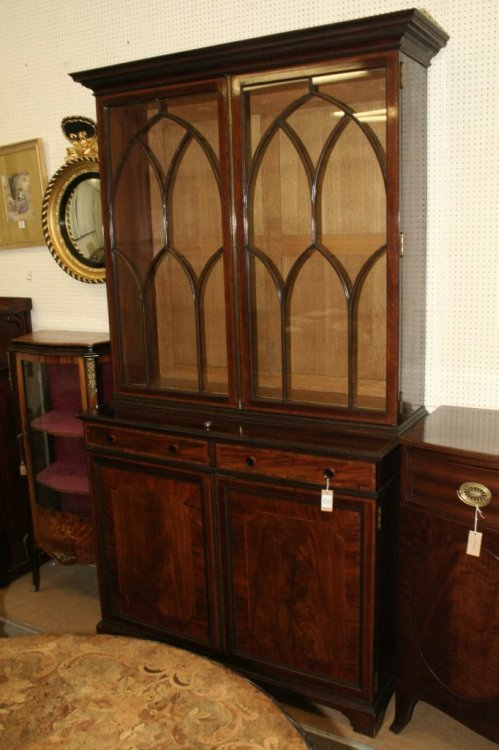 692: An Edwardian inlaid mahogany bookcase by Maple & C