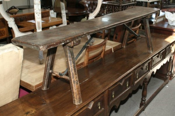 696: An 18th century oak bench, 5ft 11ins