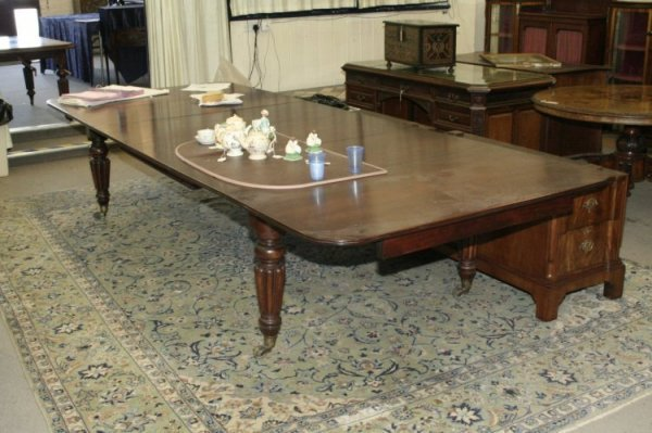 704: A late George III mahogany extending dining table