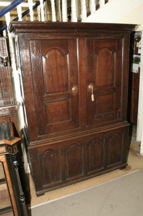 712: A mid 18th century oak cupboard, 4ft 6ins