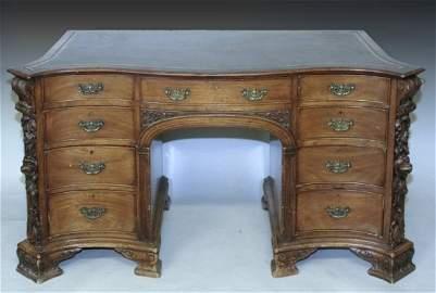 743: A Victorian mahogany serpentine desk, 5ft
