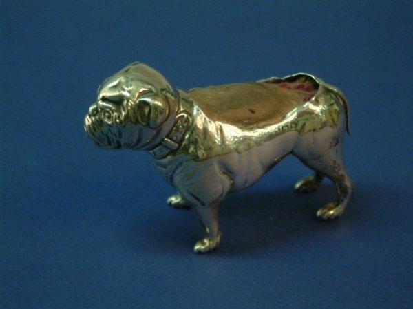 1211: An Edwardian silver bulldog pin cushion, 2.75ins