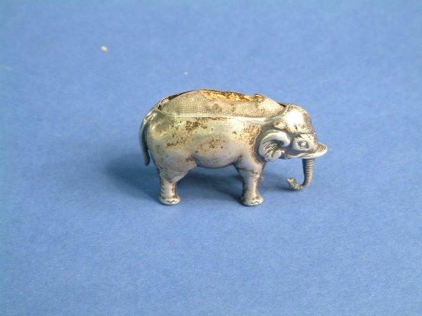 1212: An Edwardian silver elephant pin cushion, 1.5ins