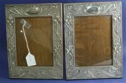 1424 A pair of Edwardian art nouveau silver mounted oa