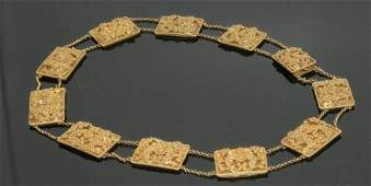 1654: An Indian gold filigree plaque necklace,