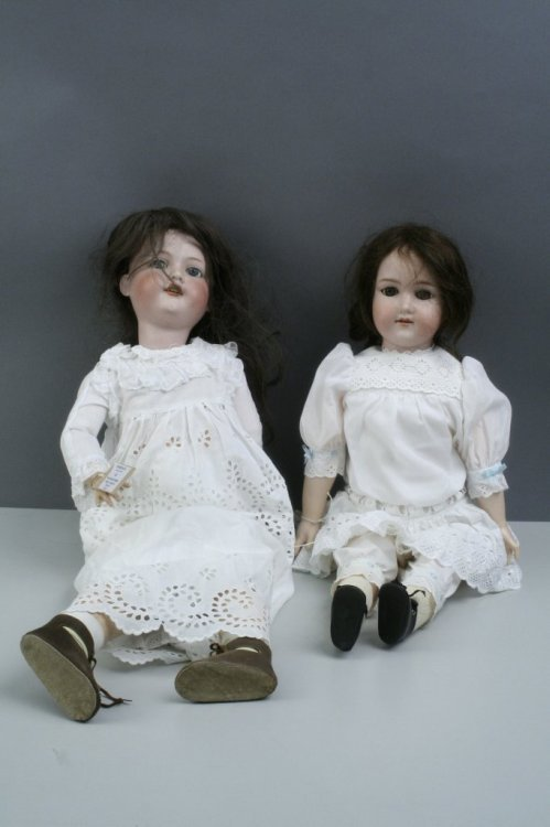 1: Two Armand Marseille bisque dolls, 26in. and 23in. -