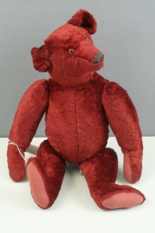 10: A deep red Teddy bear in the style of Steiff, 16in.