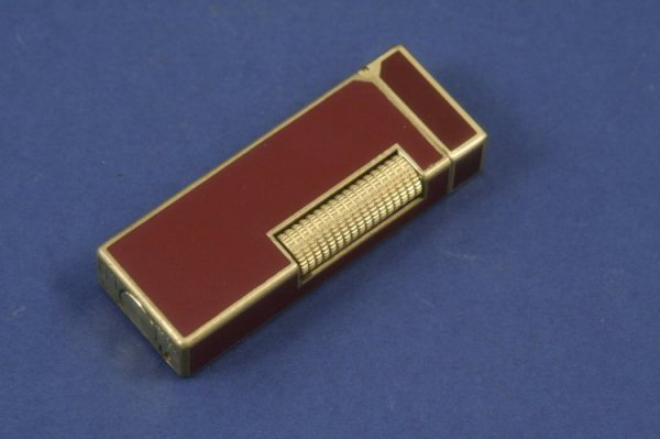 1281: A Dunhill gold plated and red enamel cigarette li