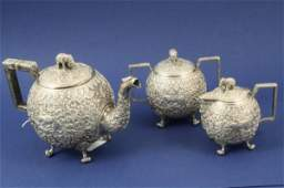 1436 A late 19th century Indian white metal three piec