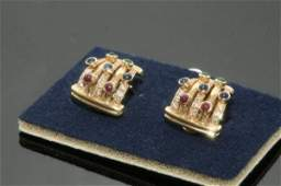 1713 A pair of gem set 18ct gold ear clips