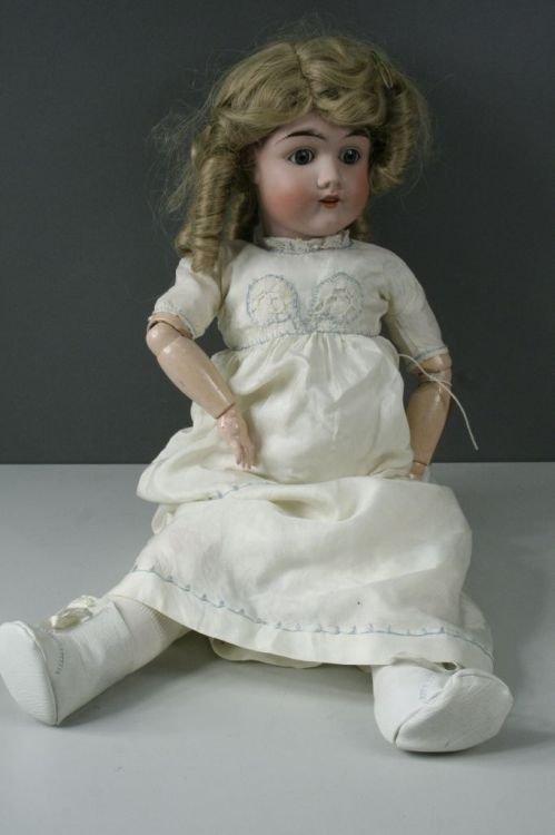 4: A Max Handwerk bisque doll, 24ins