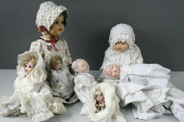 7: Three small bisque dolls and five other dolls
