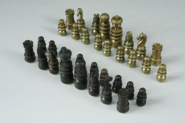 11: An early 20th century bronze and brass chess set, K