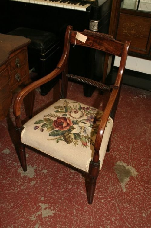 864: A Regency carved mahogany elbow dining chair
