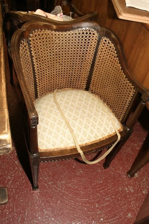 870: A pair of mahogany bergere tub chairs
