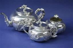 1633 A Chinese white metal three piece teaset