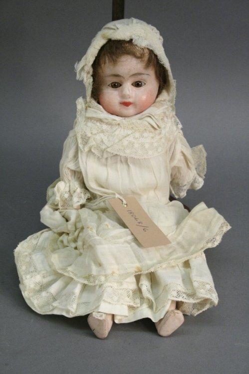 1: A wax doll, 14in.