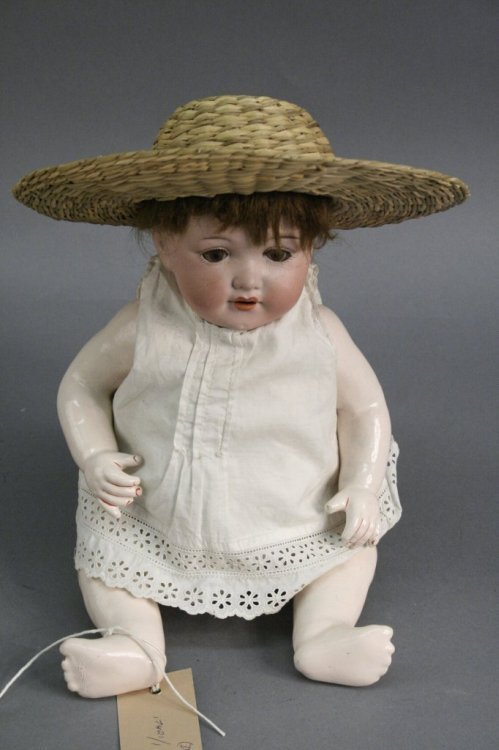 2: An Armand Marseille bisque doll, 13in.