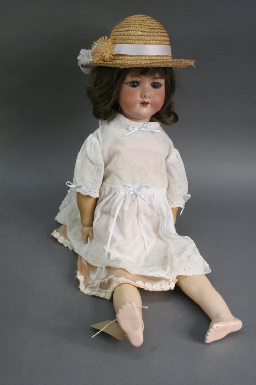 3: An Armand Marseille bisque doll, 23in.