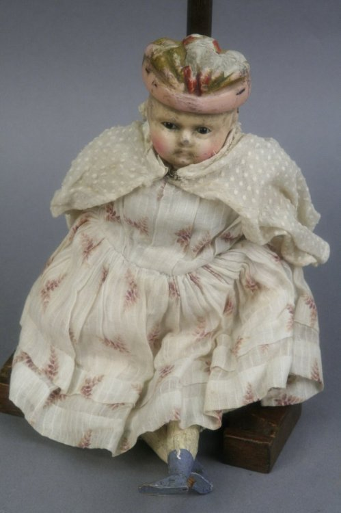 5: A late 19th century wax over composition doll, 11in.