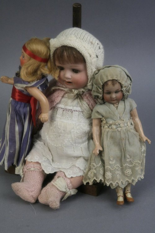 6: An Heubach Koppelsdorf bisque doll and two other sma