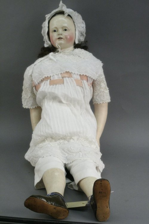8: A large George III papier mache doll, 33in.