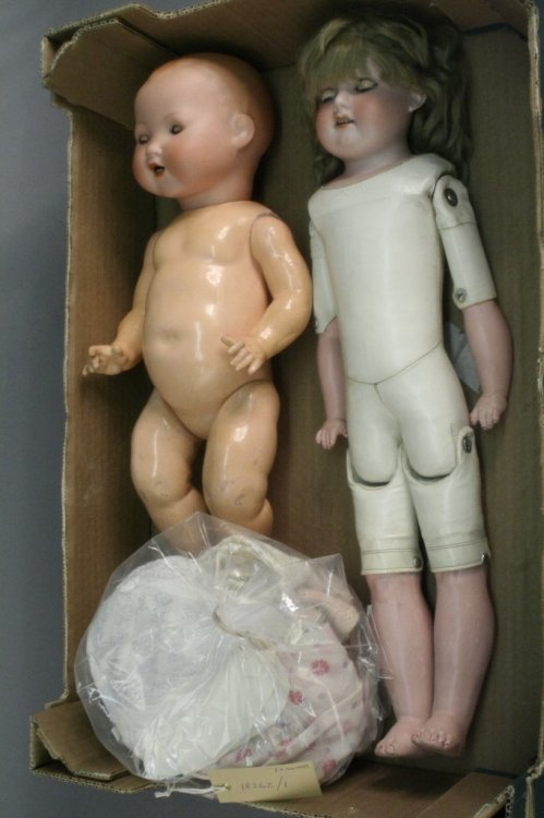 9: Two bisque dolls and an assortment of clothing