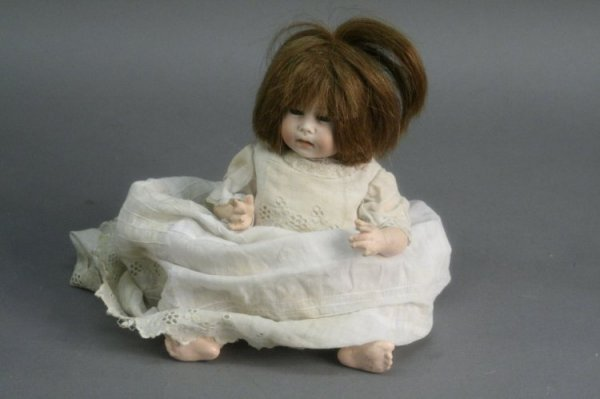 12: A German bisque doll, 10in.