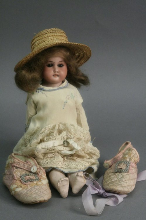 13: A small Armand Marseille bisque doll, 11in.