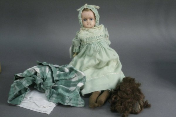 14: An English poured wax shoulder doll, 16in.