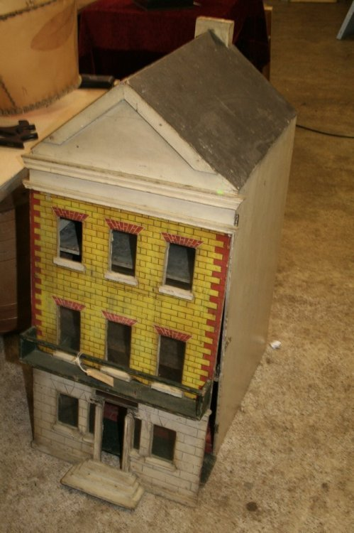 15: A 19th century painted wood doll's townhouse, 39in.