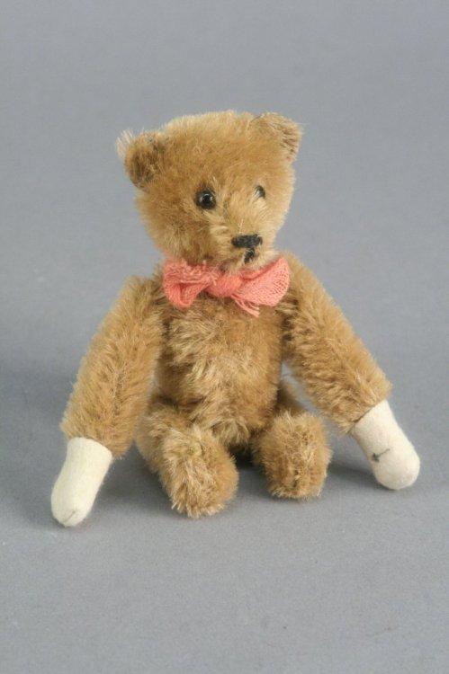 18: A Schuco clockwork tumbling Teddy bear, 5in.