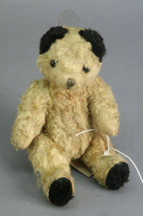 19: A small cotton plush Teddy bear, 8in.