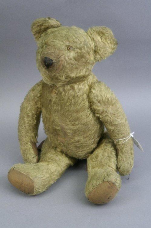 20: An early 20th century English Teddy bear, 18in.