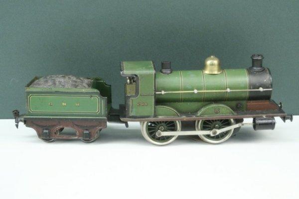23: A Marklin gauge 1 clockwork 4-4-0 locomotive and te