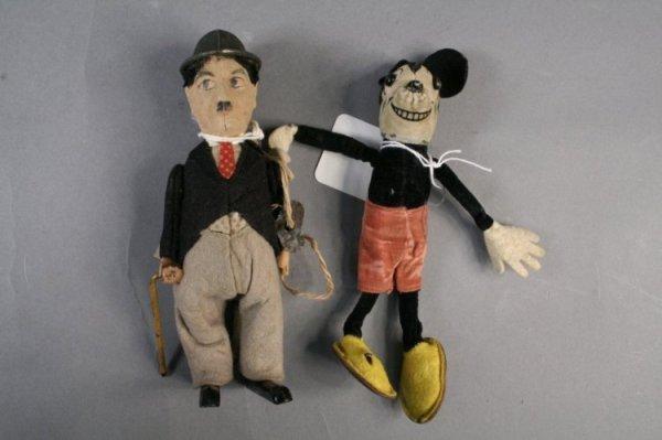 24: Schuco Charlie Chaplin and Mickey Mouse - both fair