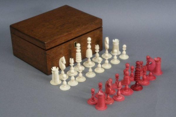 25: A 19th century turned and stained ivory chess set,