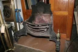 357: A George III cast iron serpentine fire basket & fi