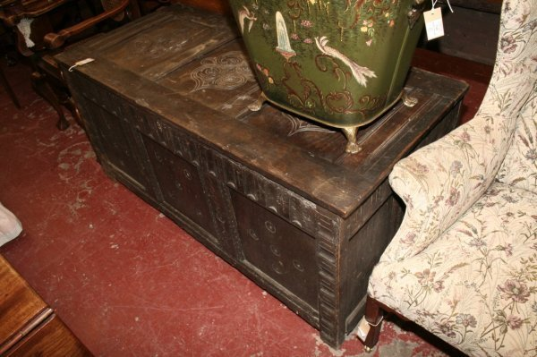 1113: A 17th century carved oak coffer, 4ft 9ins