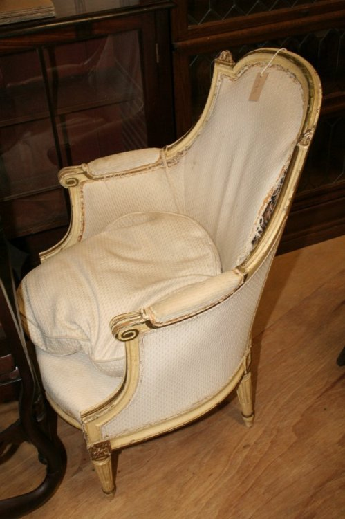 1114: A Louis XVI design gilt and cream painted fauteui