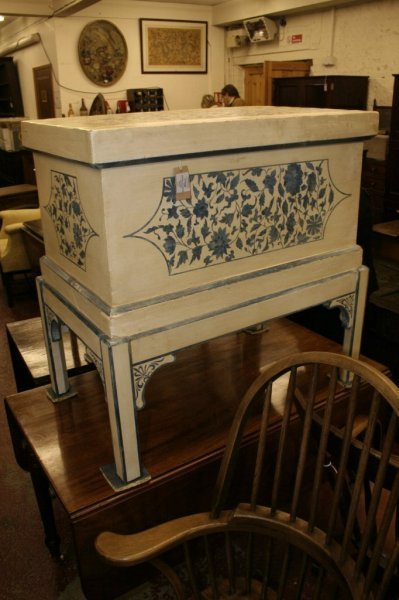 1110A: A Continental painted pine coffer on stand,