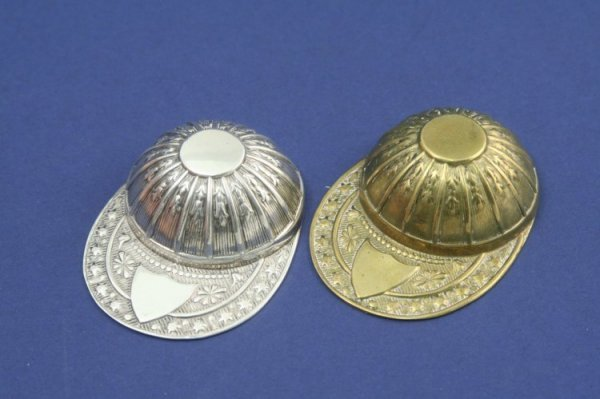 1927: A Victorian silver jockey cap caddy spoon & a bra