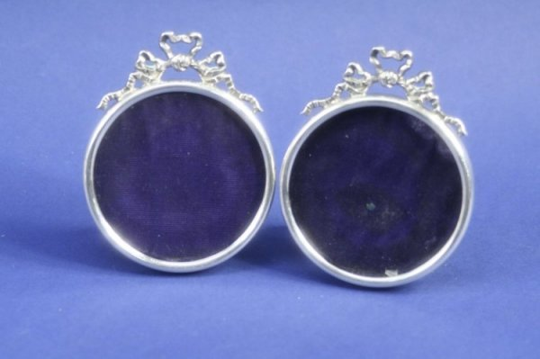 1938: A pair of late Victorian silver circular photogra