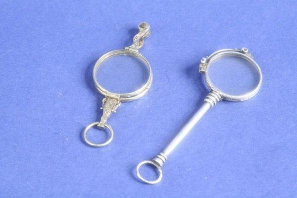 1945: A pair of late 19th century silver lorgnettes & a