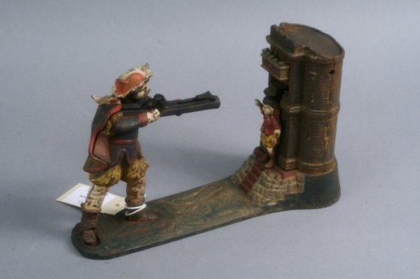 12: A cast ironWilliam tell money bank