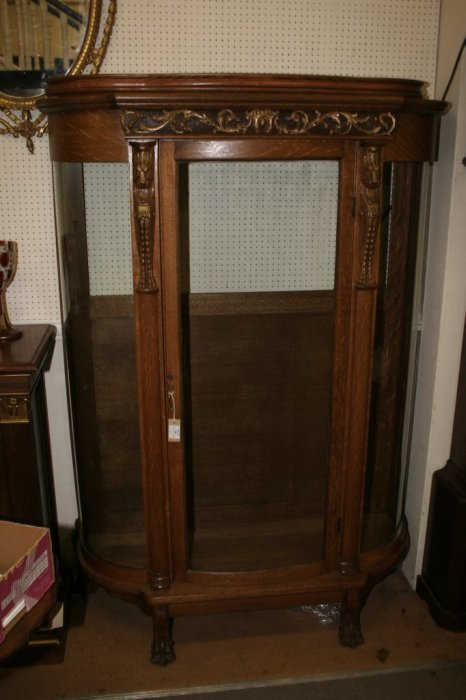 596: A Continental oak bow fronted display cabinet, hei