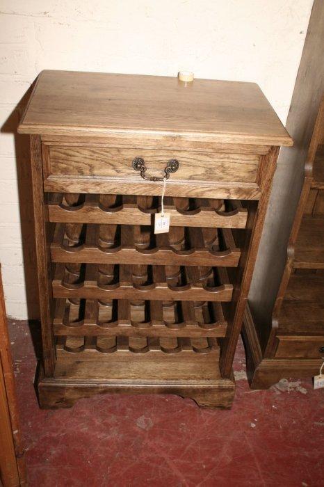 598: An oak wine rack, 1ft. 9ins.