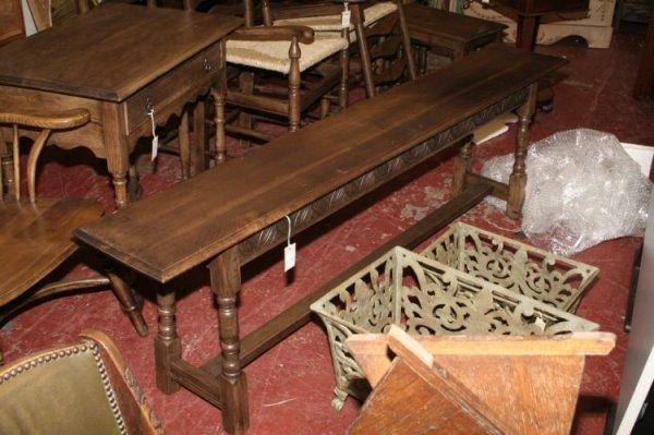 601: A carved oak bench, 6ft.