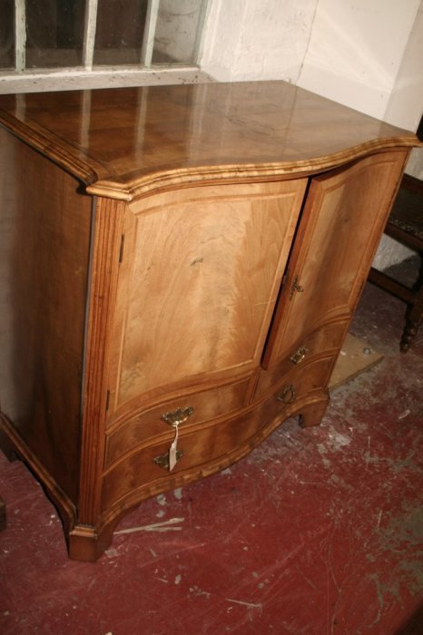 603: A serpentine walnut cabinet, 3ft 2ins depth 1ft 7.